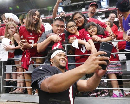 Arizona Cardinals quarterback Kyler Murray takes a selfie during training camp at State Farm Stadium July 28, 2019.