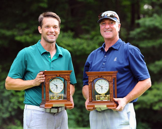 Jason Troutman (left) and Dan Brown hold the winners' clocks after capturing the W.B. Sullivan Invitational Four-Ball title last year at Lebanon Country Club.