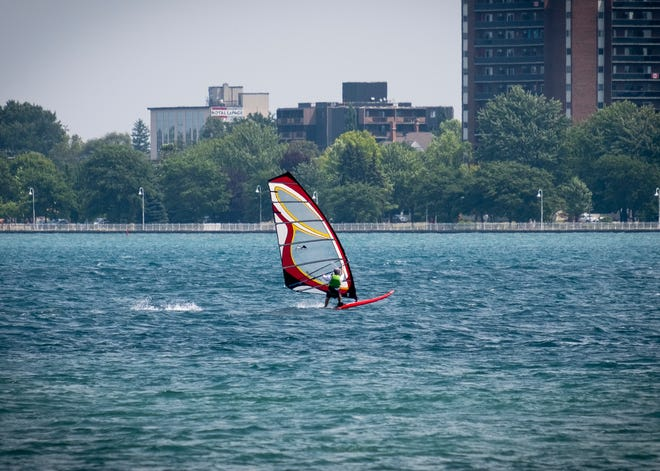 A windsurfer takes advantage of a strong south-southwest wind Monday, July 29, 2019, on the St. Clair River between Port Huron and Sarnia. According to the National Weather Service,  Monday's high was near 87 with a south-southwest around 16 mph, with gusts as high as 25.