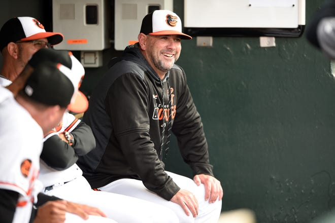 Manager Brandon Hyde, right, has his Baltimore Orioles playing their best ball of the season. The team that Hyde is leading, however, could look markedly different after Thursday's trade deadline.