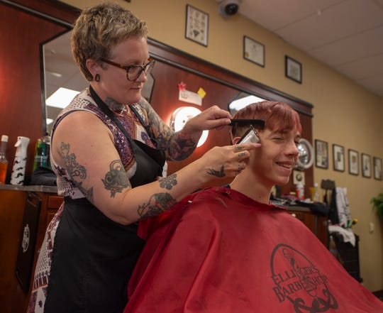 Amanda Ellinger of Ellinger Barbershop in Delta, gives Wayne Sparks of Red Lion a trim on Wednesday, June 26, 2019.