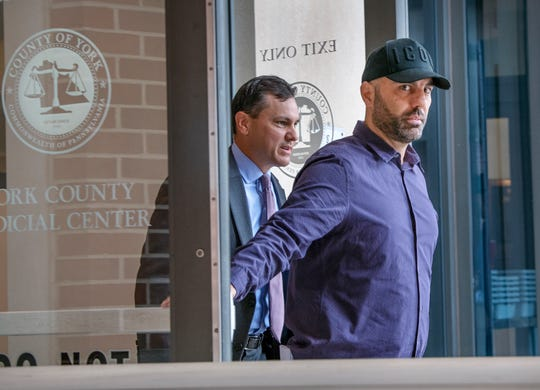 Bill Hynes, right, leaves the York County Judicial Center on Monday after a protection-from-abuse order hearing, followed by his attorney, Chris Ferro.