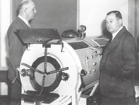The iron lung assisted polio victims to breathe. Charles B. Wolf, chair of the York Hospital board, and Dr. D. C. Pewterbaugh, a pediatrician, are shown with an iron lung in photograph taken c. 1948. (Photo from York County History Center Library and Archives)