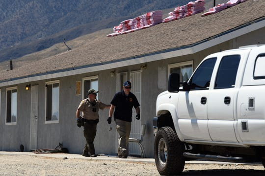 Law enforcement exit the Walker Lake apartment building associated with Santino William Legan, 19, that was searched by the FBI on Monday morning. Legan is suspected of opening fire at the Gilroy Garlic Festival in Gilroy, California on July 28. Three people were killed and 12 were injured.
