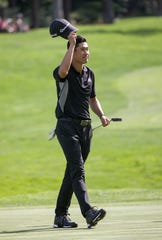 Collin Morikawa waves to the fans after winning the Barracuda Championship PGA golf tournament at Montrêux Golf and Country Club in Reno on Sunday.