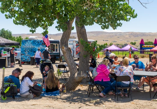 Families enjoy some shade at the Fernley Food Truck Funday Sunday.