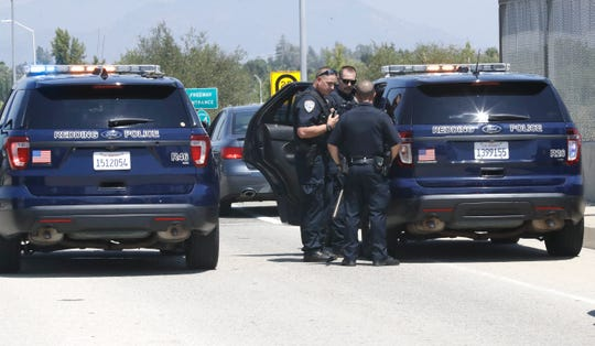 Redding police make a traffic stop on Shasta View Drive at the Highway 44 overpass on Monday, July 29, 2019, to question three people for a possible connection to a double murder in Canada. Police said those detained were not the wanted suspects but they questioned them anyway.