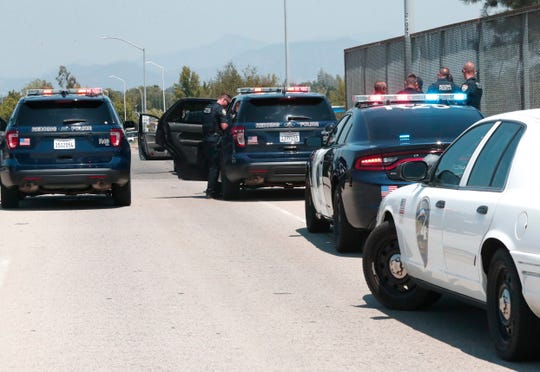 Redding police make a traffic stop on Shasta View Drive at the Highway 44 overpass on Monday, July 29, 2019, to question a couple for a possible connection to a double murder in Canada. Police said those detained were not the wanted suspects but they questioned them anyway.
