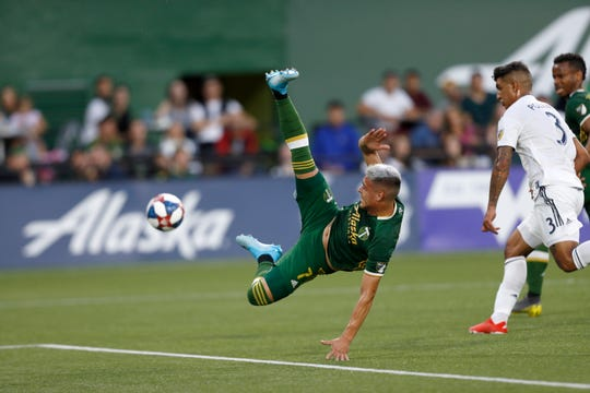 The Portland Timbers' Brian Fernandez (7) jumps for the ball during the first half of an MLS soccer match against the LA Galaxy in Portland, Ore., on Saturday, July 27, 2019.
