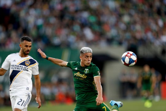 The Portland Timbers' Brian Fernandez (7) vies for the ball during the first half of an MLS soccer match against the LA Galaxy in Portland, Ore., on Saturday, July 27, 2019.