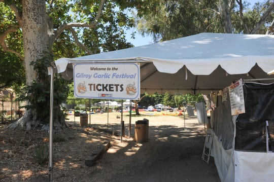 The southern entrance to the Gilroy Garlic Festival, as seen July 29, 2019, includes many trails that attendees used while fleeing the festival in Gilroy, California, on July 28, 2019.