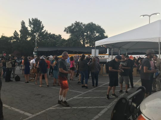 A crowd as formed at the reunification center of the Gilroy Garlic Festival shooting incident.