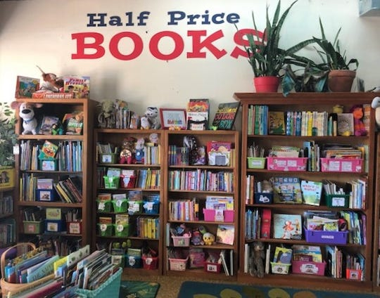 The Teacher Store's book section has a seating area and lots of half-price books.