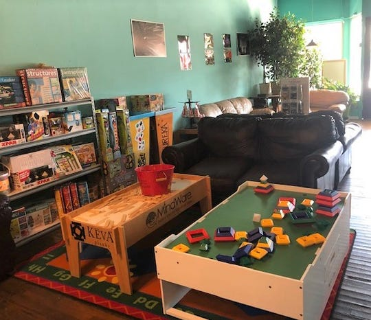 This space used to belong to a flooring company. The Teacher Store turned it into a type of game room, featuring the games sold in store.