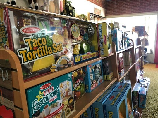 Multiple toy kits are on display at the Teacher Store, including this taco play set.