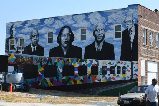 The mural takes shape as Boyd wraps up the project.