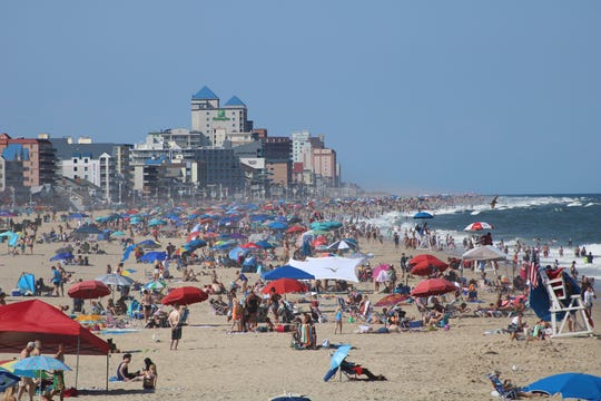 Large crowds of beachgoers enjoy the sun on Ocean City's beach on July 24 in Ocean City.