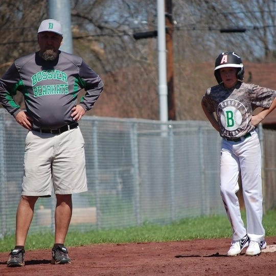 Bossier coach David Beeson and his son Coleman at a past event.