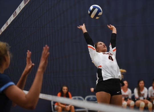 Tenley Buddenhagen of Huron High School sets the ball during the game against Unity Christian High School,  Monday, July 29, at the Sanford Pentagon.