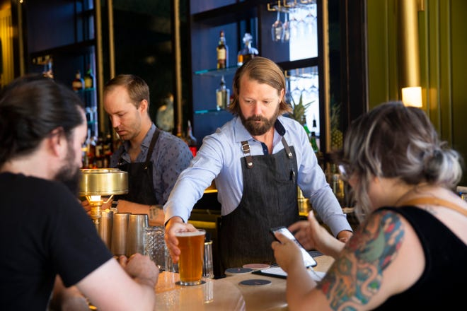 Duke DeGraaff bartends at The Treasury, a new cocktail lounge in downtown Sioux Falls, Monday, July 29. The Treasury is located at 100 N. Phillips Ave.