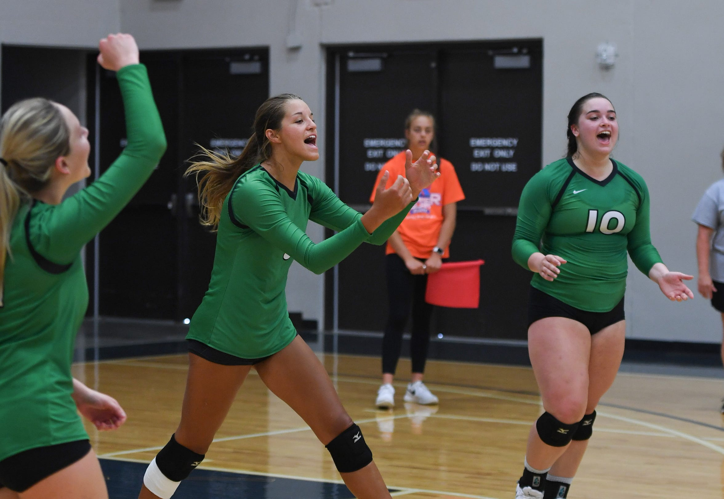 Miller's Kadye Fernholz celebrates with her teammates during a match at the Summer Slam Invite.