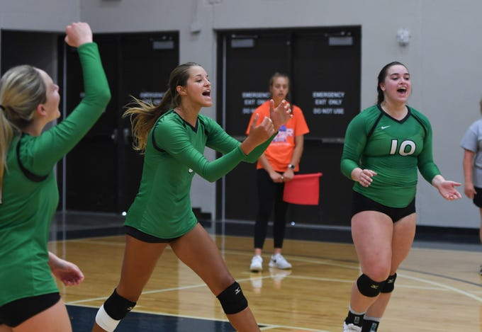 Miller High School volley ball team celebrates during the Summer Slam Invite, Monday, July 29, at the Sanford Pentagon.