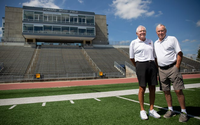 John Simko and Jim Luce, star players from the legendary 1956 Washington High School football team, pose for a portrait, Wednesday, July 24, at Howard Wood Field.