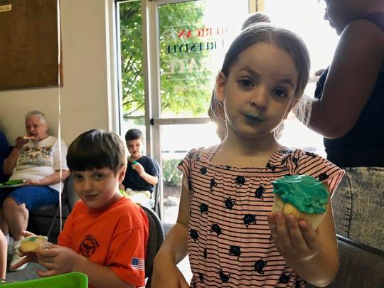 Nicolas and Rosalind Francesca Church-DiCiccio eat birthday cupcakes at American Freestyle Karate in Staunton, Virginia, on Saturday, July 27, 2019.