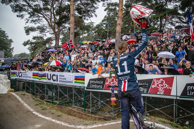 Alise Willoughby celebrates with the crowd Saturday after winning with the 2019 UCI BMX World Championships in Zolder, Belgium.
