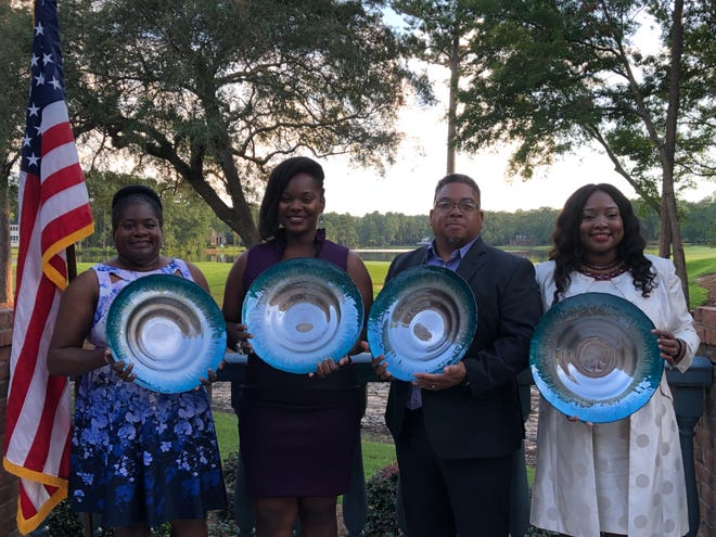 From left:  Acquinonette Bryant, M.D., Renee Gordon, Ph.D., Andrew Chin, and Lililita Forbes are honored.