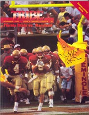 Steve Gilmer, center, leads Florida State out of the tunnel at Doak Campbell Stadium.