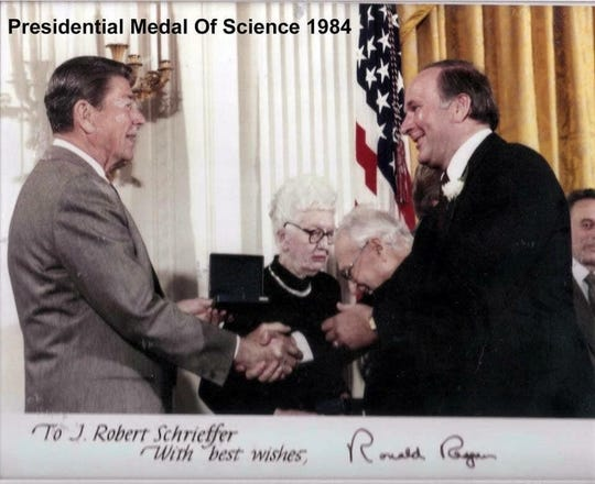 John Robert Schrieffer, right, receiving the Presidential Medal of Science in 1984 from President Ronald Reagan.