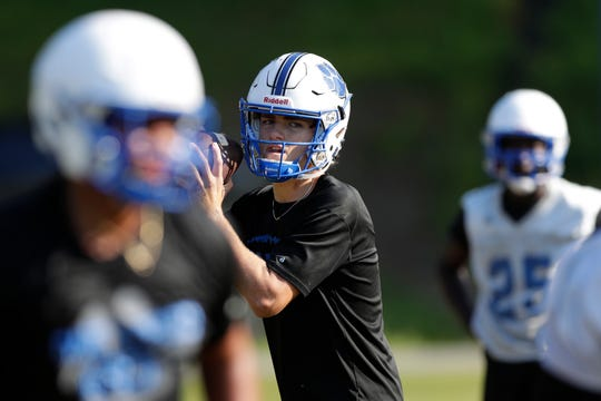 Godby quarterback Trey Fisher practices with his Cougars team during their first practice of the fall on July 29.