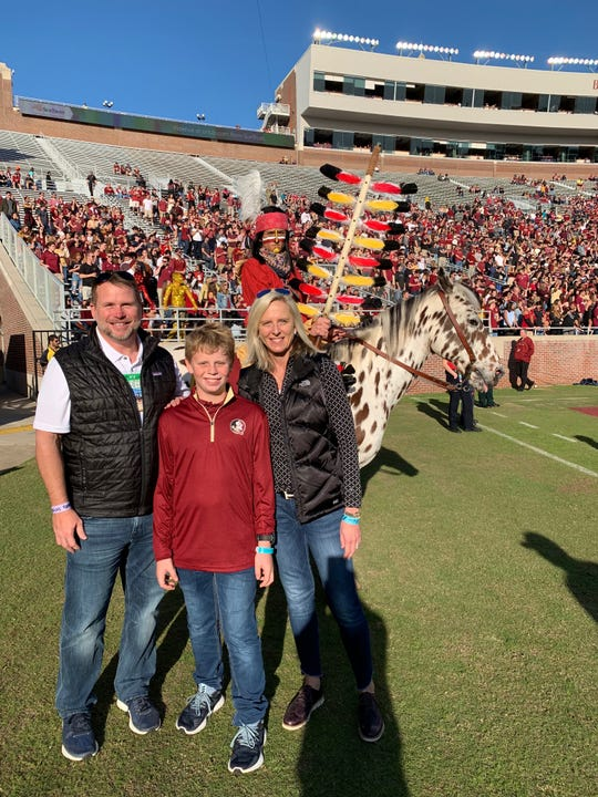 Steve Gilmer with wife Karen and their son Jacob at Doak Campbell Stadium last fast.