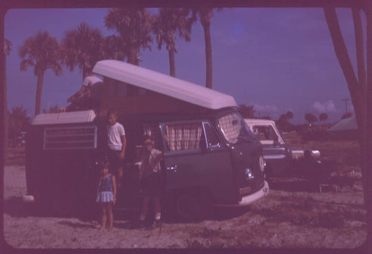 The Shaffer family trip to watch Apollo 11 with brother Dan, sitting along side of his sister, Lura. and Steve standing at the doorway of our family VW camper on the beach south of Cape Canaveral.