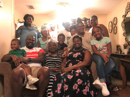 FAMU football head coach Willie Simmons (front left) gathers with the McNeal family for Sunday dinner at his grandmother Mildred McNeal's (front center) house in Quincy. This weekly tradition features tasty food and close bonding.