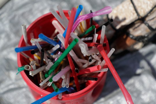 A Folgers container full of plastic straws sits at the steps of the Florida Historic Capitol, part of a giant 3,000 pound pile of garbage brought to the Capitol by Plastic Symptoms Co-Founders Bryan Galvin and Heather Bolint Monday, July 29, 2019.