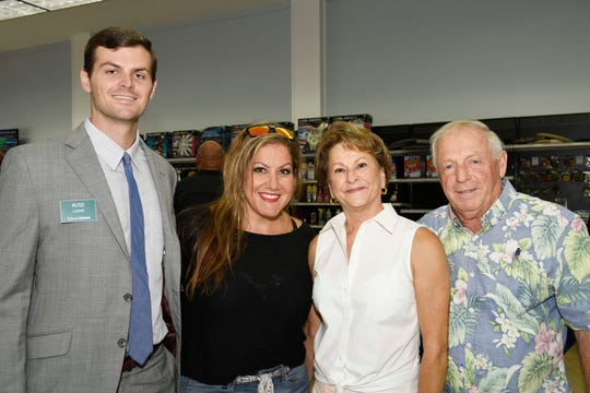Russ Laine, left, of Edward Jones; Lynette Marraffa, of Traxx Entertainment; and Doris Vickers with St. Lucie Battery & Tire founder Joey Miller at the St. Lucie County Chamber of Commerce's July Business and Social Hour at St. Lucie Battery & Tire in Fort Pierce.