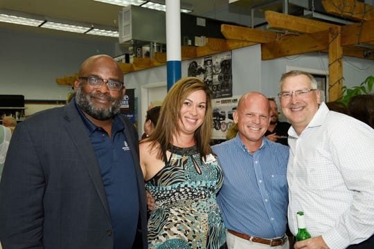 Will Armstead, left, Anita Fischer, Dan Pimpo and Jeff Emmeluth at the St. Lucie County Chamber of Commerce's July Business and Social Hour at St. Lucie Battery & Tire in Fort Pierce.
