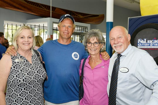 Joanne McCurdy, left, of McCurdy & Co. Realty, Don and Ann Spaeth, of Freedom Boat Club and John Heaning, of McCurdy & Co. Realty at the St. Lucie County Chamber of Commerce's July Business and Social Hour in Fort Pierce.