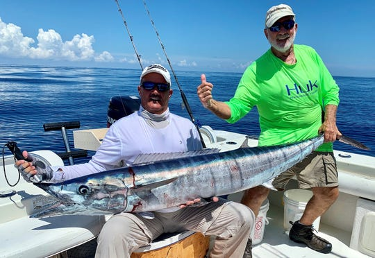 Capt. Rick Pino and angler Bob Sonnenberg aboard Pino's Starycat caught this 80-pound wahoo on a cut pogey for bait while bottom fishing for grouper and snapper in 100 feet of water northeast of Sebastian Inlet Friday.