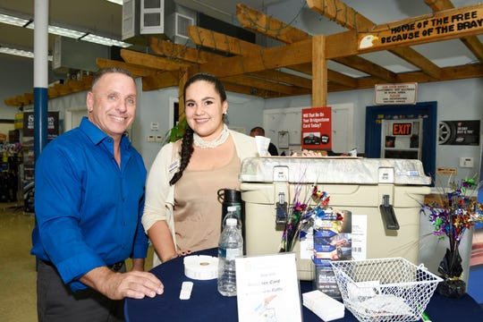 St. Lucie County Chamber of Commerce's Mark Trembley and Katherine Cordero  at the chamber's July Business and Social Hour at St. Lucie Battery & Tire in Fort Pierce.