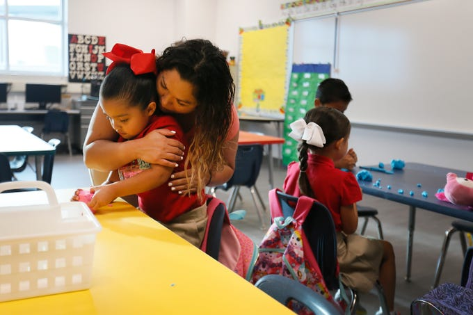 Sarahi Lara gives her daughter Vivian, 4, a hug while leaving her in her classroom for her first day of Pre-K at Cactus Trails Elementary Monday, July 29, in El Paso.