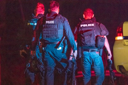 Law enforcement officers from multiple agencies continue to investigate the scene on Monday, July 29, 2019 where four people were killed and another 15 injured during the Gilroy Garlic Festival. The shooting was reported around 5:41 p.m. on Sunday near the north side of the festival.