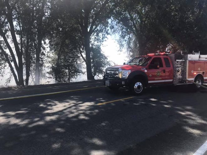 Tulare County firefighters are battling a grass fire at Road 196 and Avenue 312.