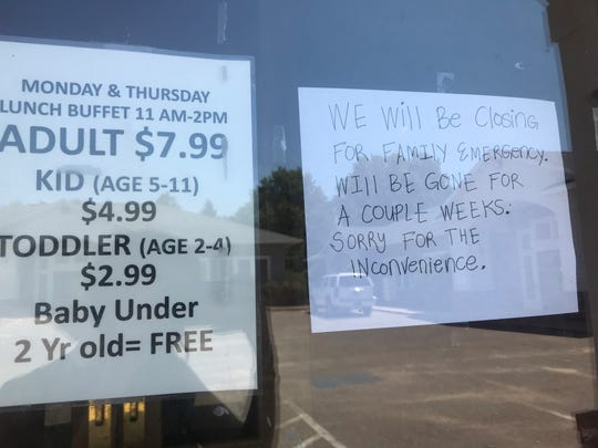 A sign on the door of Sawadee Thai Restaurant tells customers that it will be closed for a couple weeks for a family emergency. The sign was posted as of at least July 12. By the afternoon of July 29, the sign was gone and the doors still locked.
