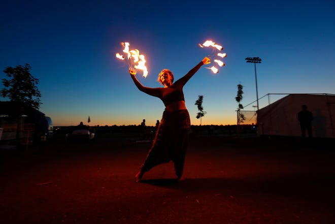A dancer performs with fire to entertain the crowd during the third annual Hmong Wausau Festival in 2019.