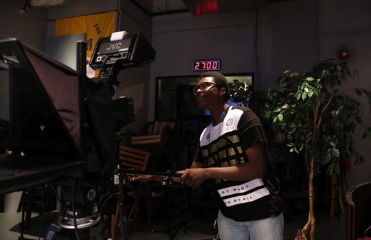 Noe DeFranc, 17, a production assistant at White Plains Cable Television, sets up the shot for a show July 25, 2019 in White Plains. DeFranc will be a senior at White Plains High School in September and has plans to study electrical engineering in college.