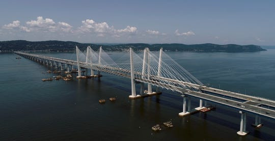 Pilings of the old Tappan Zee Bridge can be seen next to the Mario Cuomo Bridge July 26, 2019.