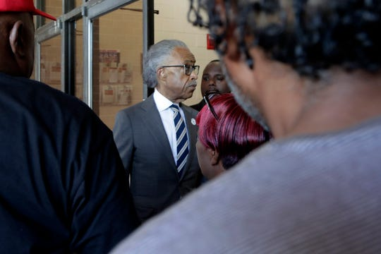 Rev. Al Sharpton, center, President of National Action Network, enters New Shiloh Baptist Church after talking to reporters, Monday, July 29, 2019, in Baltimore. After a weekend of attacks on Rep. Elijah Cummings, D-Md., the son of former sharecroppers who rose to become the powerful chairman of the House Oversight and Reform Committee, President Donal Trump expanded his attacks Monday to include Sharpton, a prominent Cummings defender, who visited Baltimore to hold a press conference in condemnation of the president.